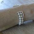 Le bracelet de perles de Béatrice